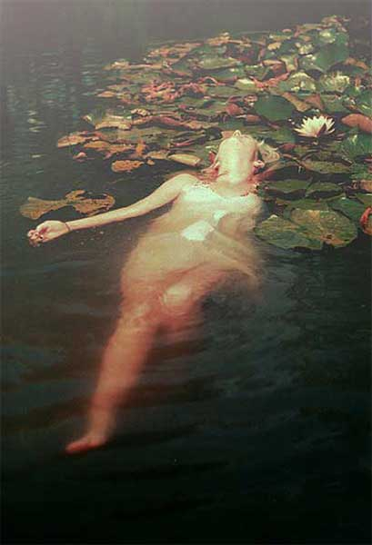 Woman swimming in lilly pond